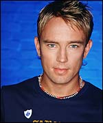 Simon Thomas wearing his Blue Peter badge